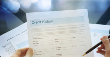 Why should you obtain a credit report before buying a house?
